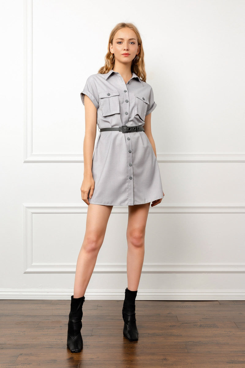 Blonde female model wearing grey utility-style shirt dress