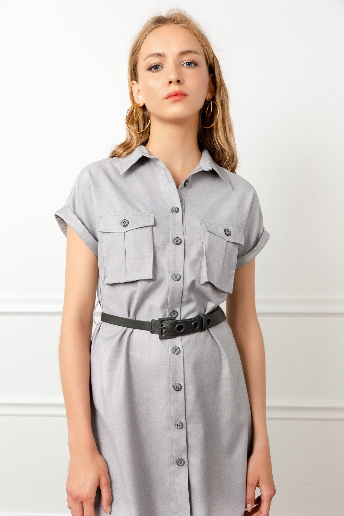 Model in grey Utility Dress Shirt with Belt by J.ING