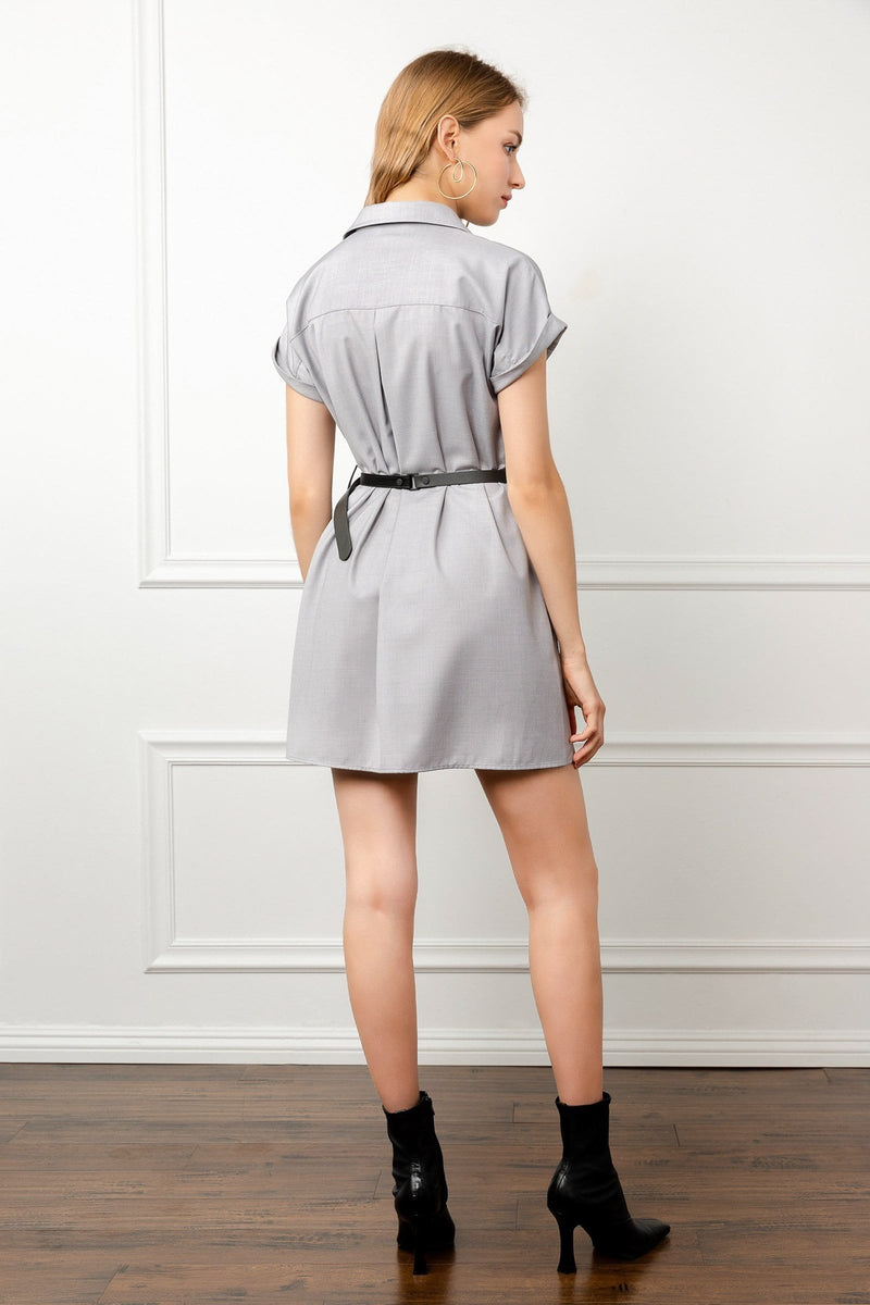 back of girl wearing utility dress by j.ing