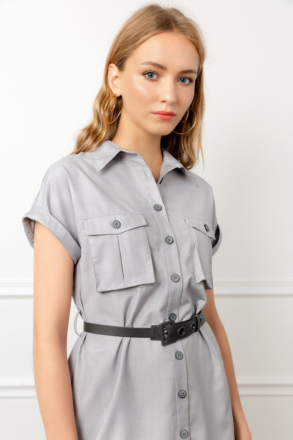 Blonde model wearing grey utility shirt dress by J.ING
