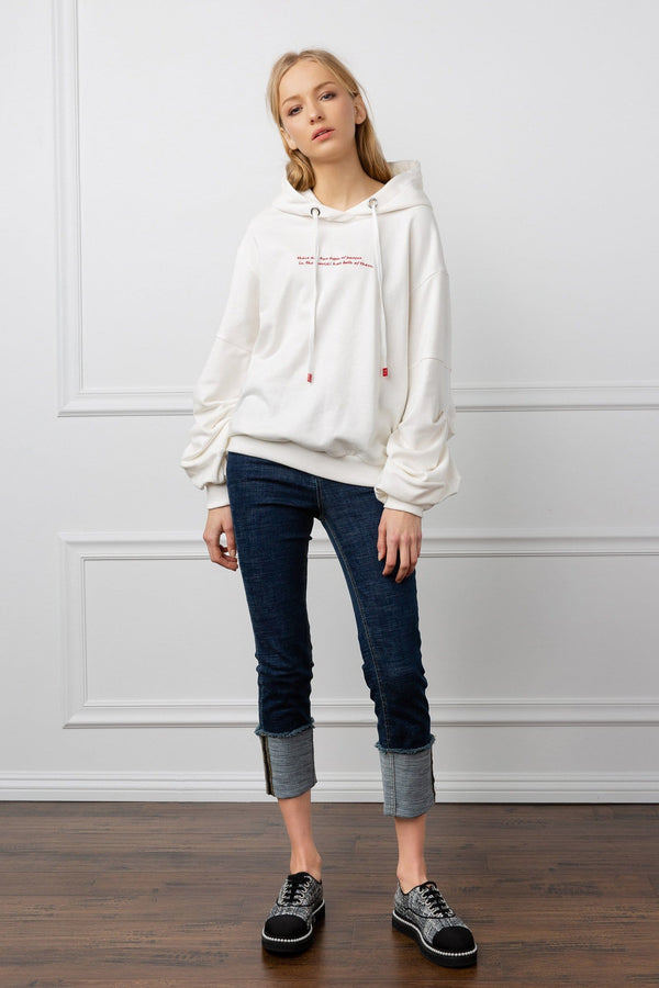 Oversize white women's hoodie sweater with embroidered wording by J.ING women's apparel