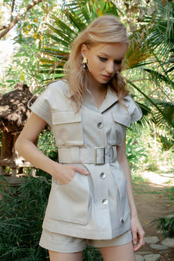 Blonde model in safari style outfit by j.ing