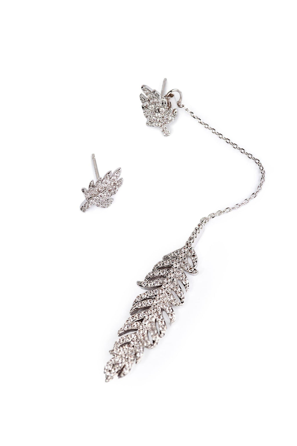 Silver colored asymmetrical earrings encrusted in zircon crystals with hanging leaf pendant | J.ING women's accessories