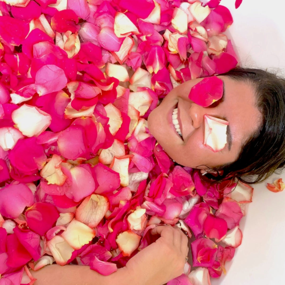 A girl in a bathtub of flower petals, enjoying the floral flavor of sleep