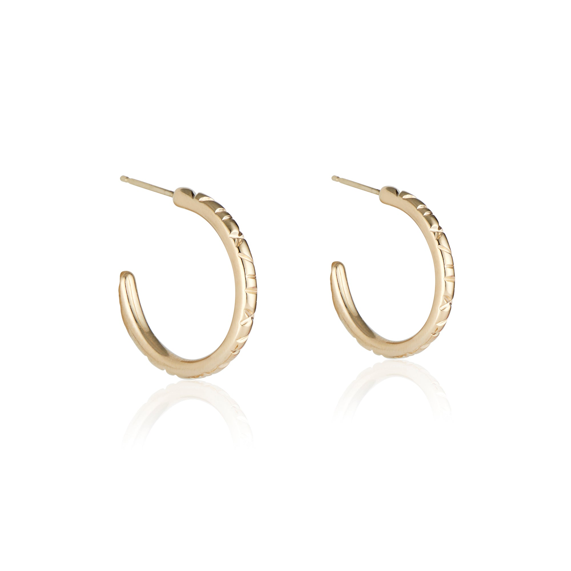 The Sunday hoop earrings by Natalie McMillan are perfect for the lover of a small every day hoop that still makes a statement. Solid gold, yet lightweight with 14k yellow gold posts and backs for an easy on, easy off hoop (although you're never gonna want to take them off)!