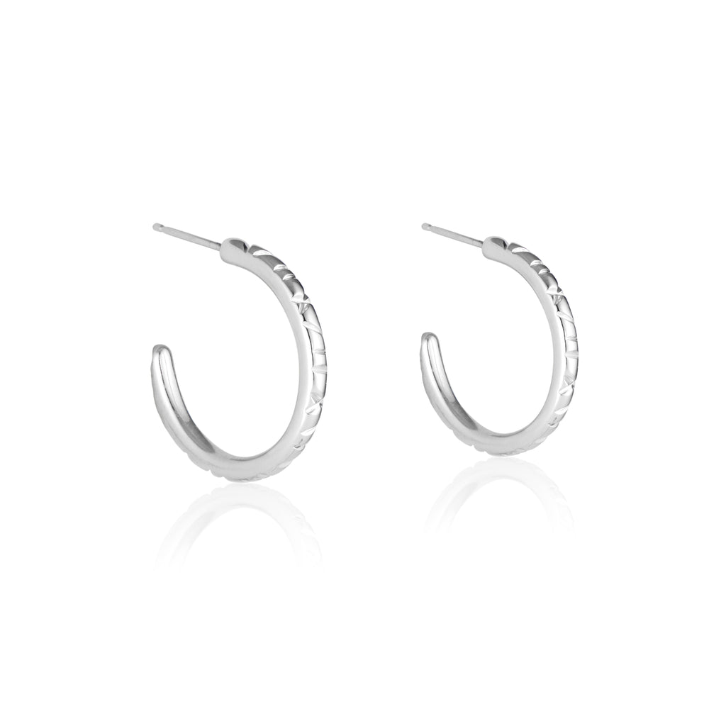 Easy like Sunday morning! The Sterling Silver Sunday Hoops are perfect for the lover of a small every day hoop that still makes a statement. Lightweight with sterling silver posts and backs for an easy on, easy off hoop (although you're never gonna want to take them off)!