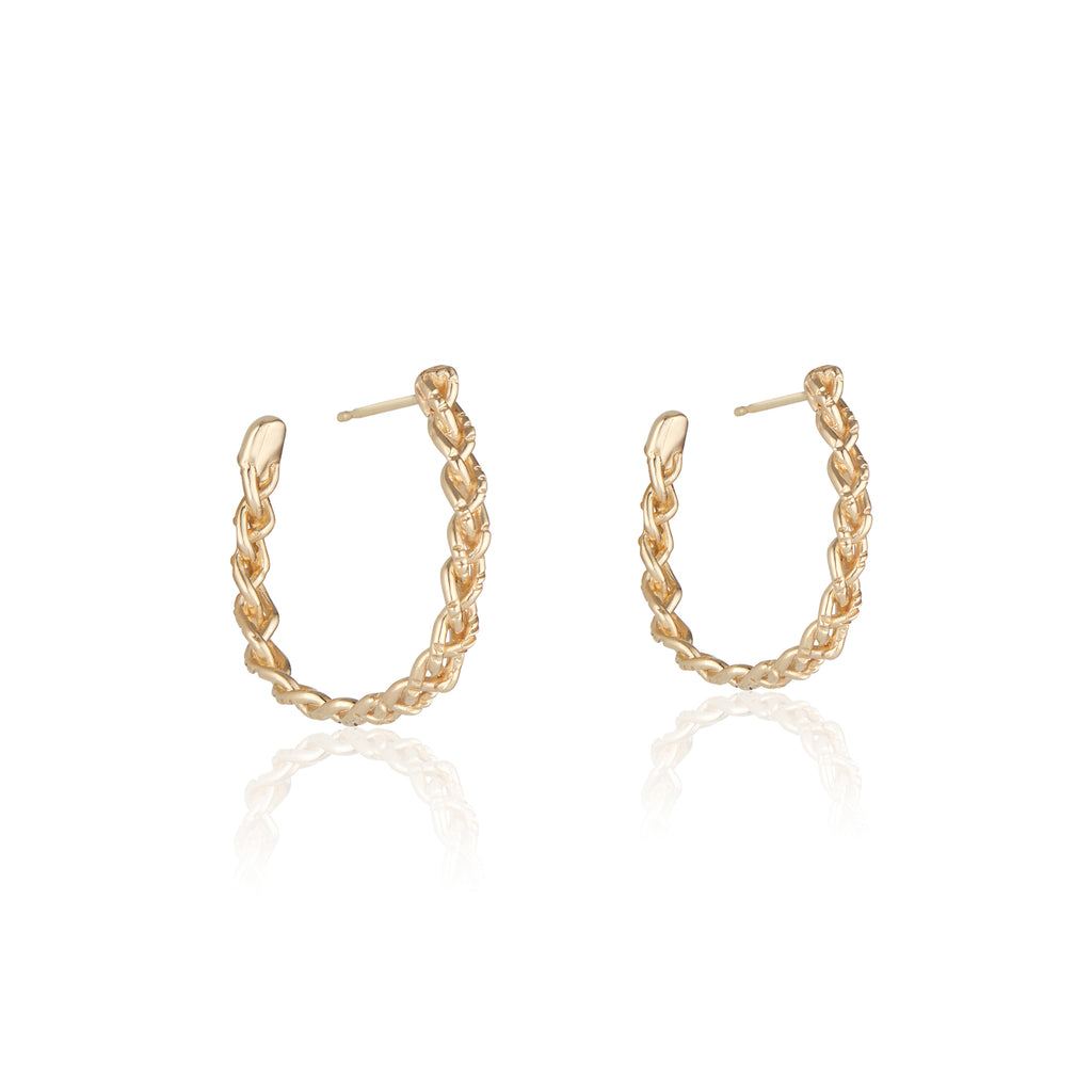 These solid 14k gold Cassandra hoops made in LA by Natalie McMillan are a great way to wear hoops without the weight!