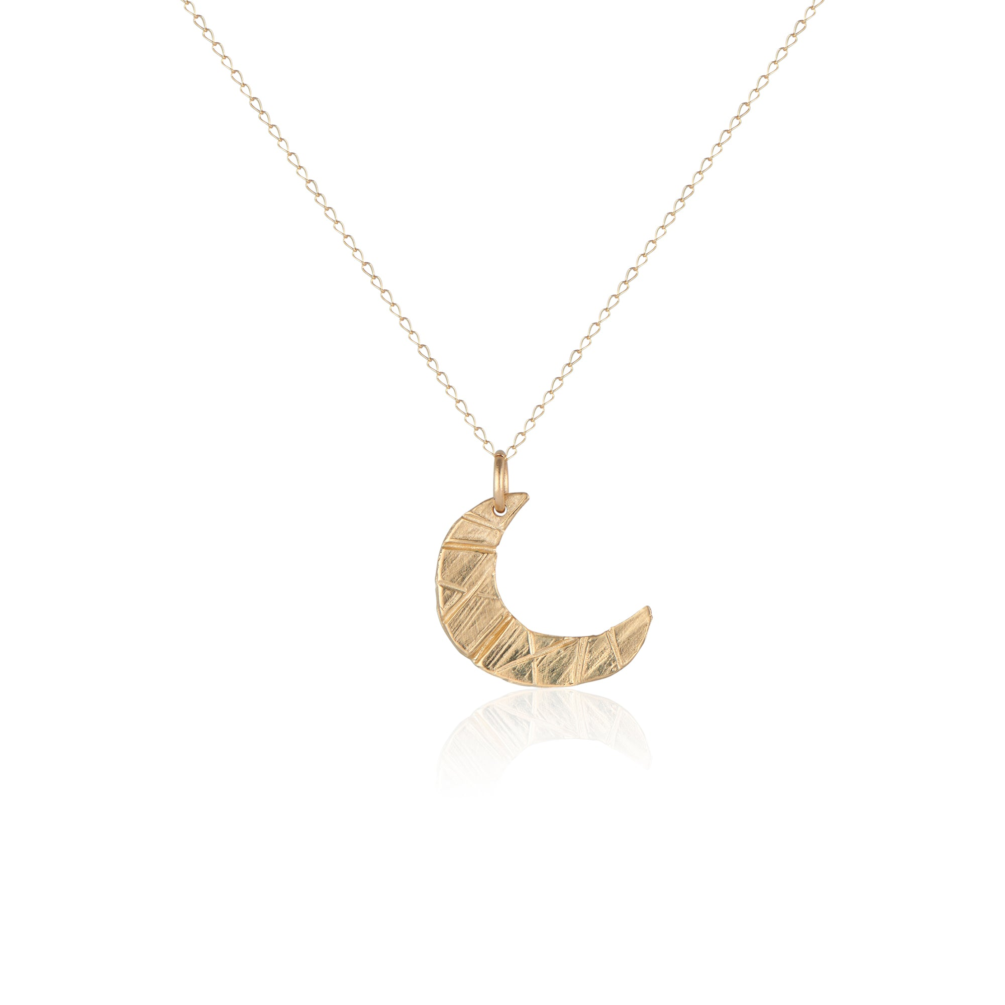 The Natalie McMillan moon shaped 14k gold pendant delicately hangs on a fine 14k gold chain. Perfect for layering or wearing on its own for a dainty, every day look.