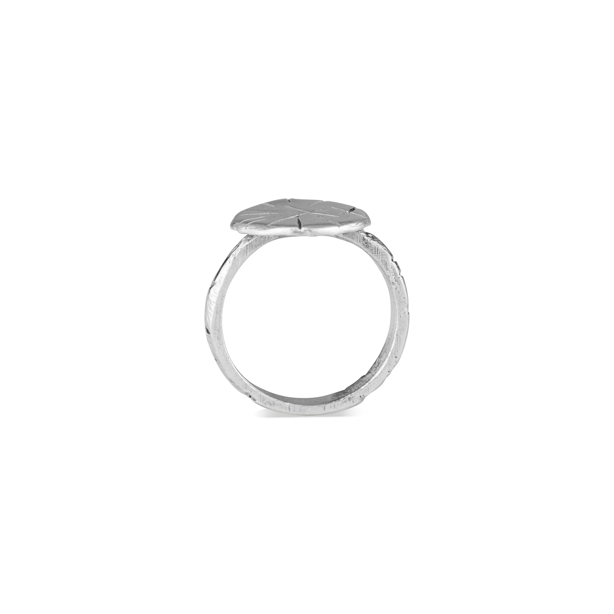 The Natalie McMillan Gina Ring is a must have for anyone who likes a solid, comfortable ring that can be worn daily! Its thin band is hand carved with Natalie McMillan Jewelry's signature markings and features a thin circle that lays flat against the finger.