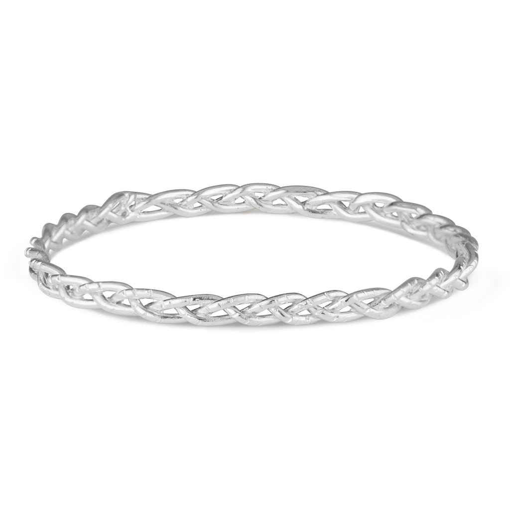 The Lillian solid Sterling Silver bangle is a gorgeous piece to have on your wrist at all times. Slightly chunky, yet still understated and never heavy or uncomfortable. Goes beautifully with the Casandra Hoops and Taylor Ring!
