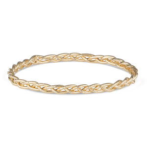 The Natalie McMillan 14k Gold braided Carrie Bangle is a gorgeous piece to have on your wrist at all times. Slightly chunky, yet still understated and never heavy or uncomfortable. Goes beautifully with the Casandra Hoops and Taylor Ring!