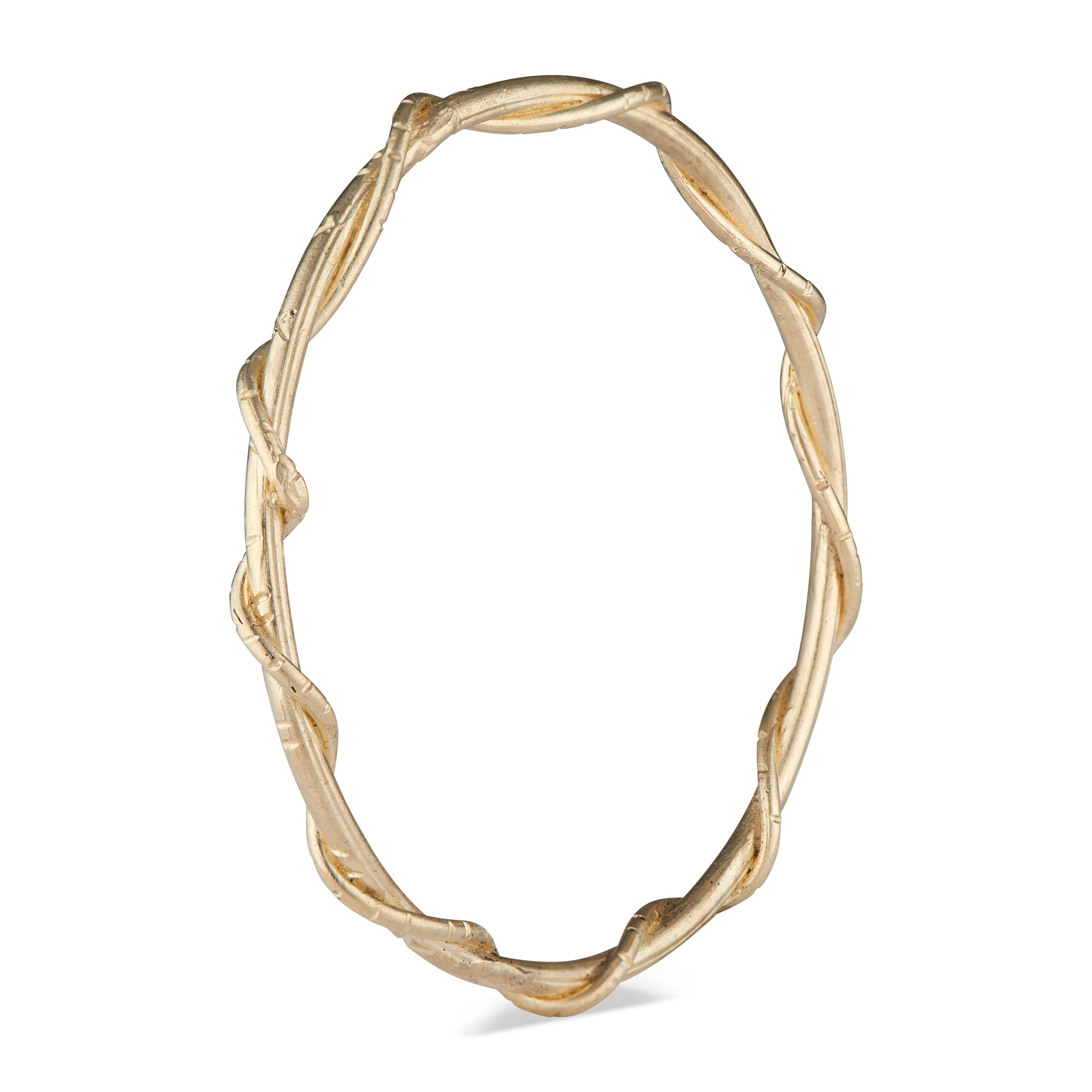 The Natalie McMillan 14k Gold Marina Bangle is a beautiful sculpturesque piece of jewelry that is sure to be on your wrist for years to come.