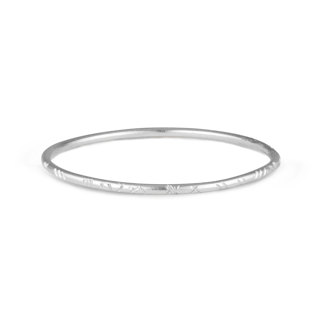 Handcrafted in LA by Natalie McMillan, the Sterling Silver Emily Bangle is a perfect addition to ANY outfit. Dressed up or dressed down, this bangle goes with absolutely anything. With comfort and wearability in mind, this bangle is super lightweight. Stack them up, wear them on their own, or mix and match them with your other favorites.. they're versatile!