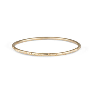 The 14k Solid Yellow Gold Emily Bangle designed by Natalie McMillan, is a perfect addition to ANY outfit. Dressed up or dressed down, this bangle goes with absolutely anything.