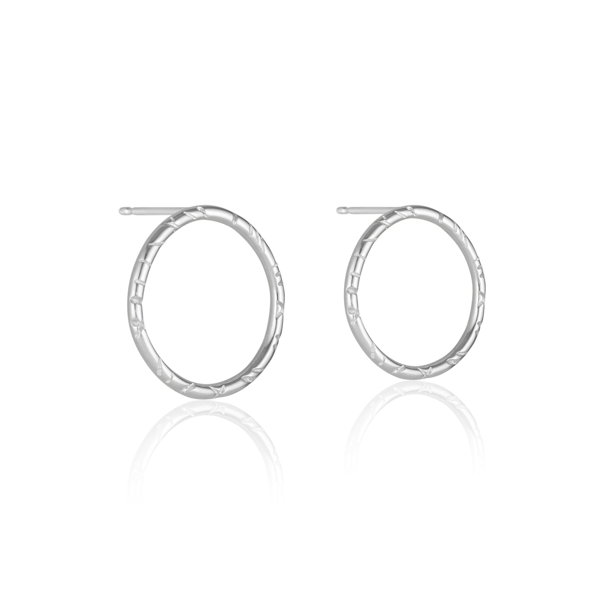 Chic, understated, and a touch of fun, the Madeline Earrings are an incredibly comfortable pair of sterling silver studs that can be dressed up or down for truly any occasion. They are the perfect pair to wear to the office, or out on the town!