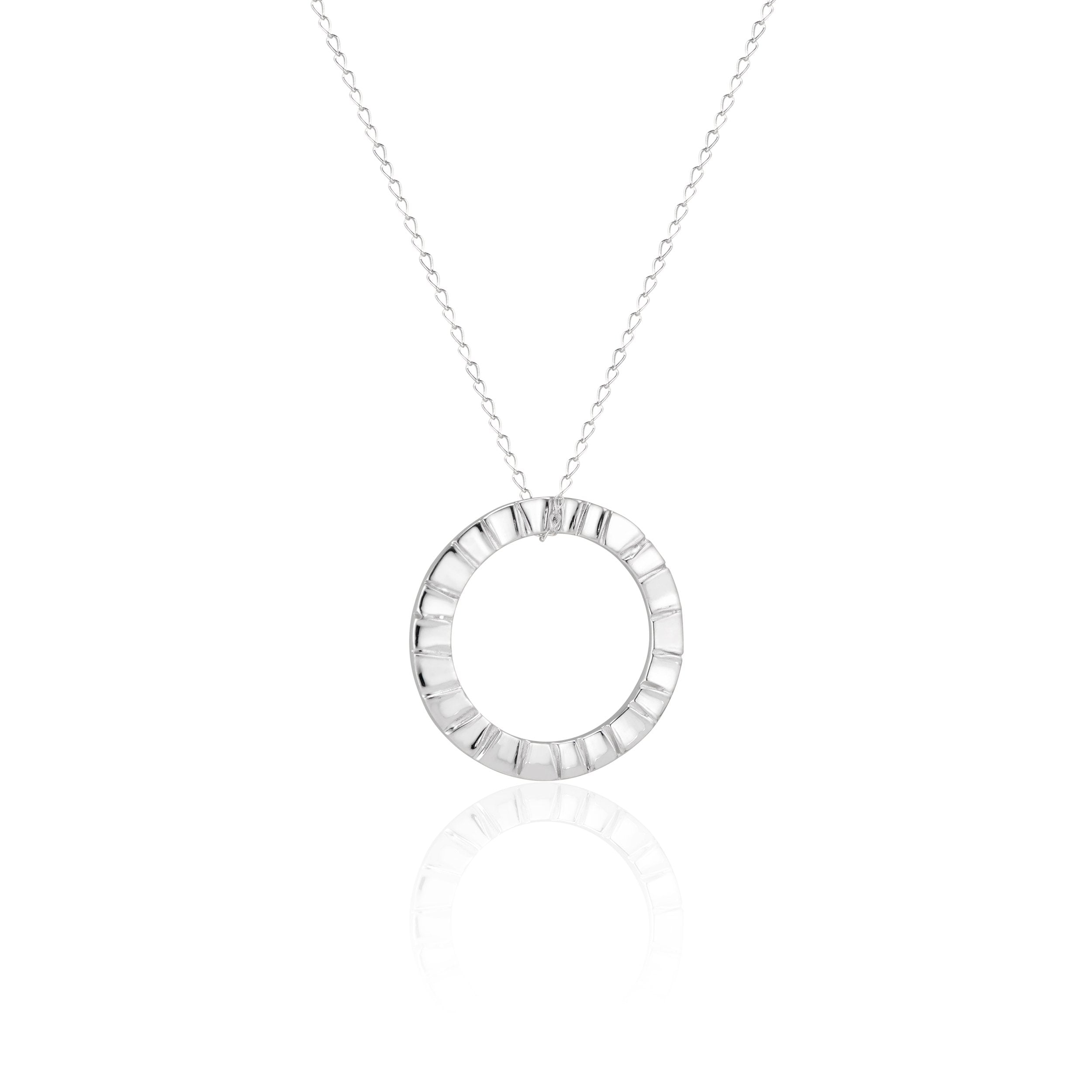 Natalie McMillan's Signature Piece and Best Seller! This delicate sterling silver necklace features a textured circular pendant on a delicate sterling chain. It is, as always, handcrafted and made to order! It is super comfortable for every day wear. Once you put it on, you'll never take it off!