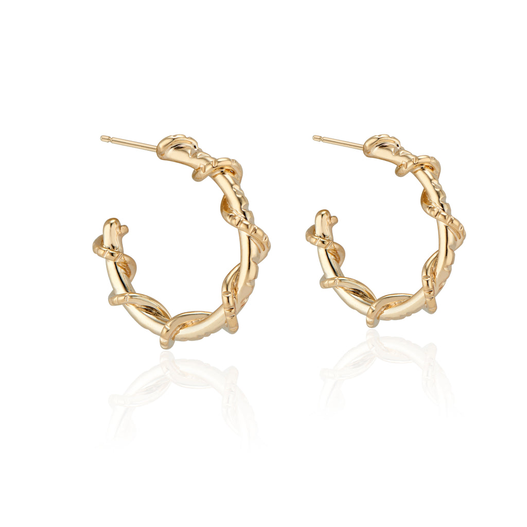 Edgy and fun, these mid sized Spike Hoops feature Natalie McMillan's signature etchings with a literal twist. They are made of solid 14k Gold, so you can wear them every day for a lifetime!