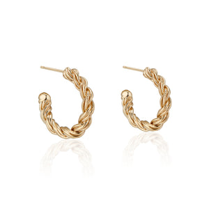 These solid 14K Yellow Zeppelin Gold Hoops feature 14k Gold posts and earnuts and are safe for sensitive ears. Their twisted design gives them the appearance of being heavy, while actually being lightweight. In true Natalie McMillan fashion, there are tiny etching details throughout.