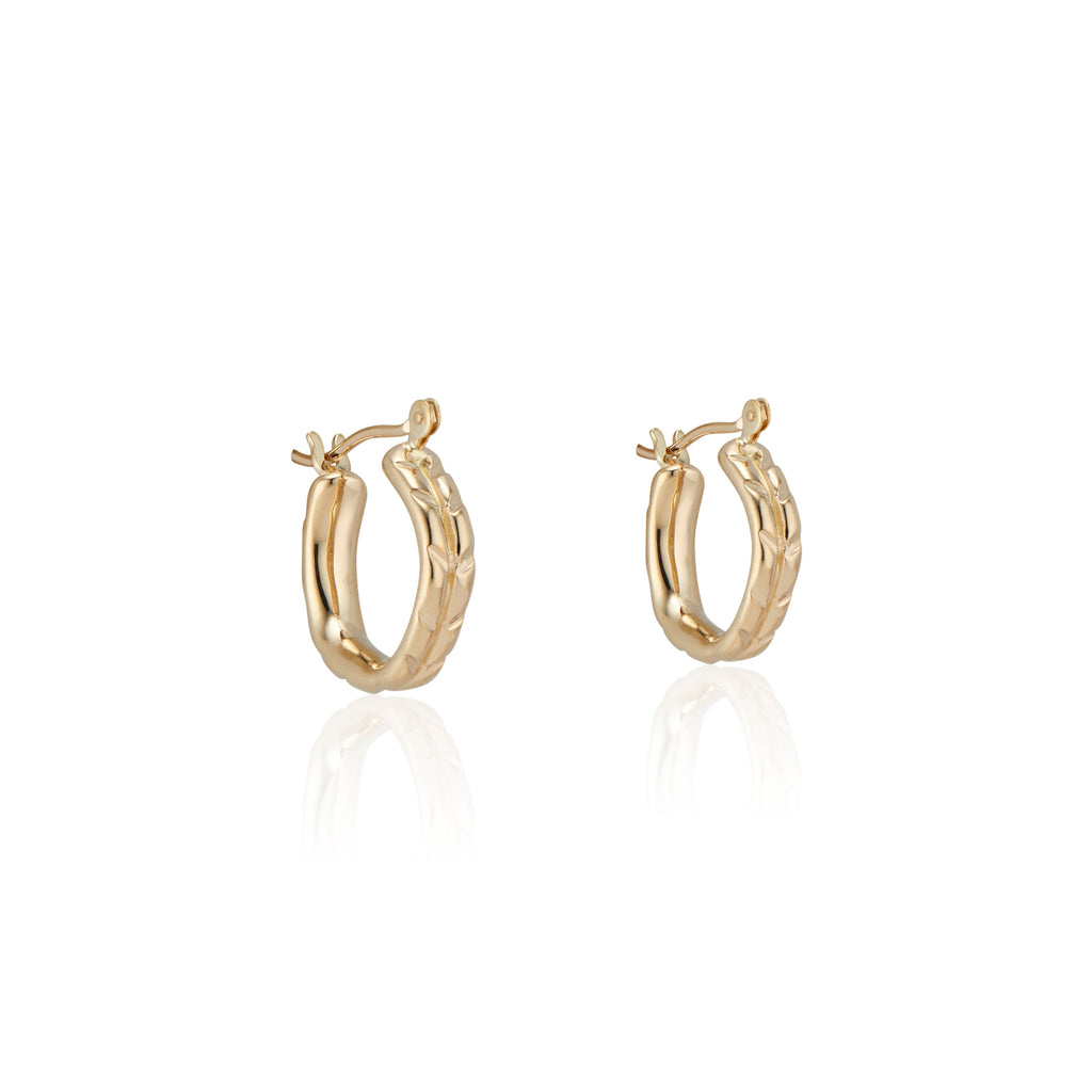 The Natalie McMillan solid 14k Gold huggie style hoops feature a hinge post and latch back for easy on and easy off wear!