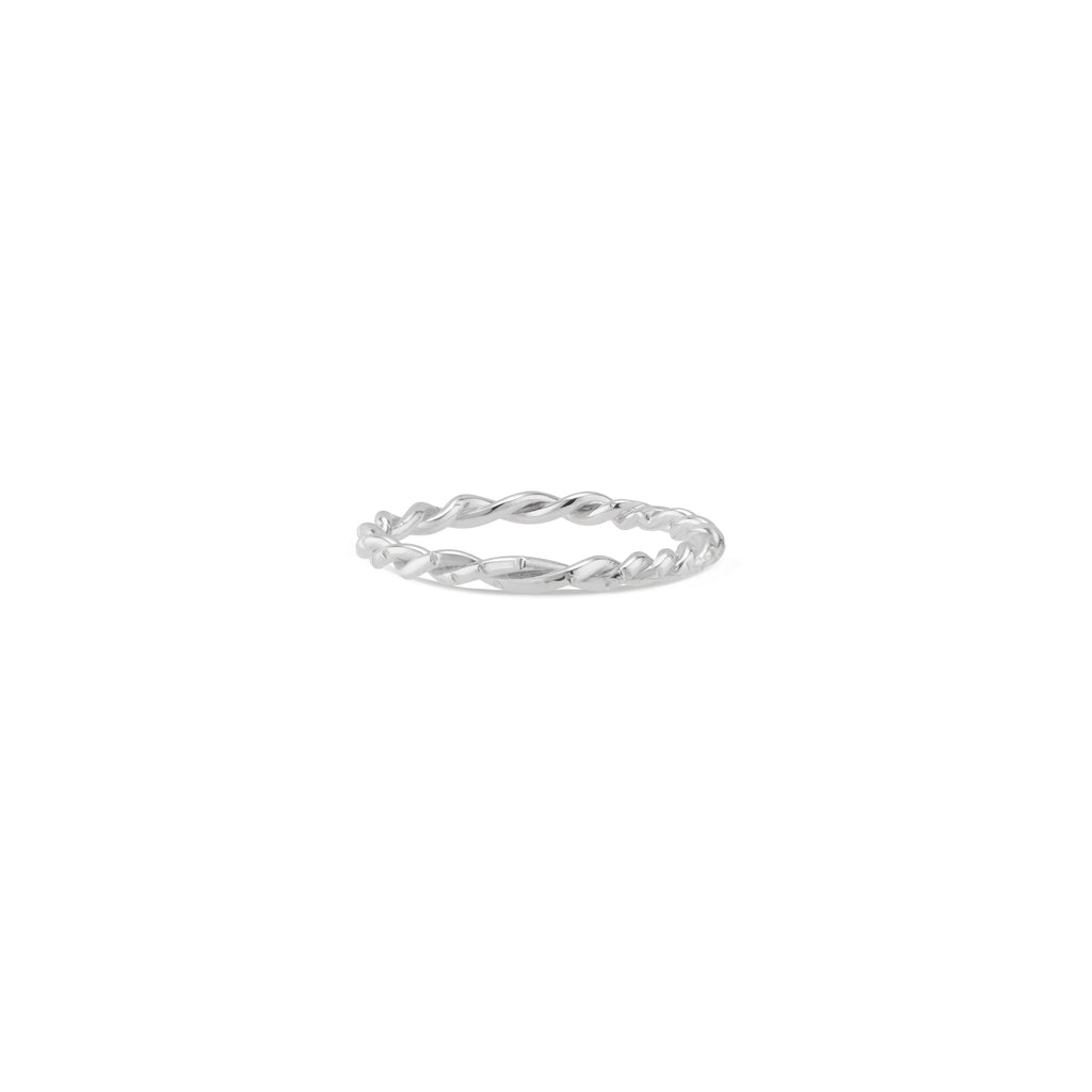 This solid sterling silver twisted band features Natalie McMillan's signature etchings. It is the ultimate stacking ring, as its thin, twisted design effortlessly goes with any ring it gets paired with! It looks especially incredible in a stack of all Lauren rings in mixed metals!