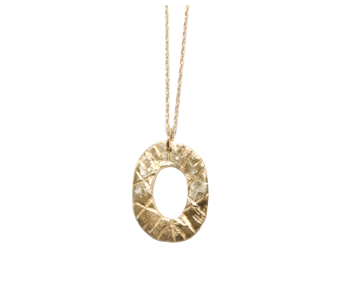 "This textured 14k Gold oval pendant designed by Natalie McMillan hangs on a fine 20"" chain. It is a wonderful addition to wear along one of our signature everyday necklaces, or on its own."