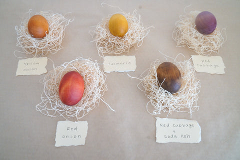 Naturally-dyed wooden egg in turmeric, red onion, yellow onion, red cabbage, and red cabbage + soda ash