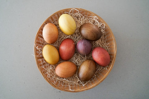 naturally dyed wooden eggs in a basket