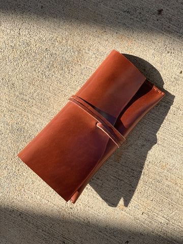 a handmade clutch leather bag in cognac color