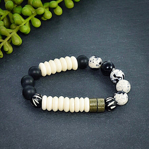 Black and White African Beaded Bracelet with Pyrite and Carved Bone - Afrocentric jewelry