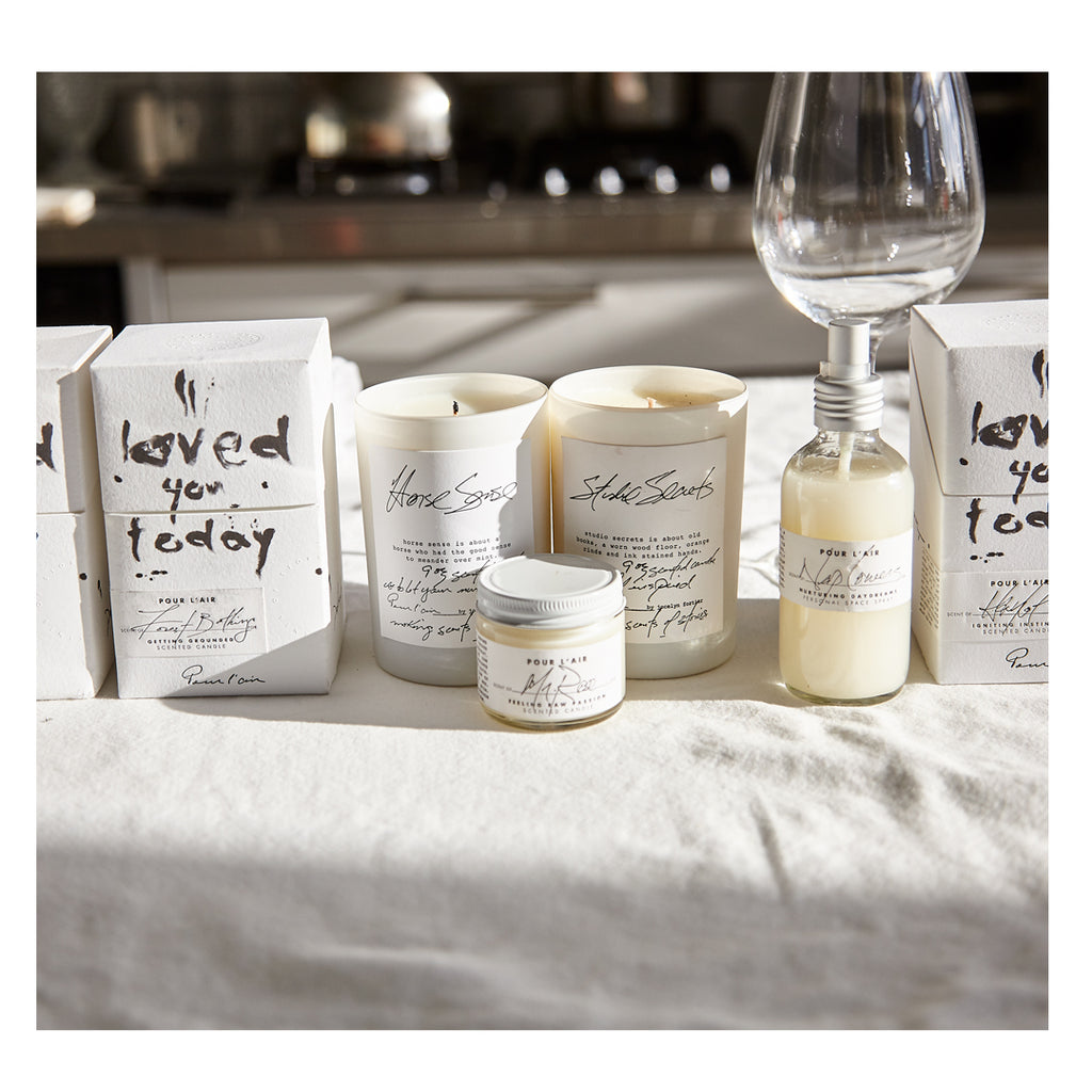 Pour l'air gift guide shows how to shop by intention. Candles for home decor.