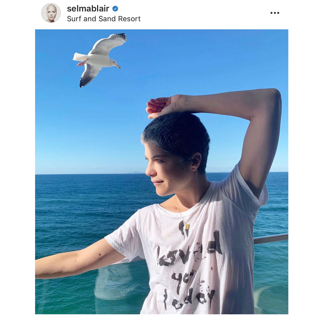Selma Blair in the Pour l'air Scents I loved you today tshirt. A positive message reminding you to look for something to love in each day. It's wearing gratitude.