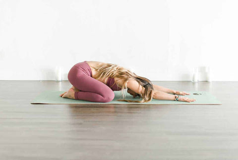 Childs Pose in Yoga Studio on Cork Yoga Mat