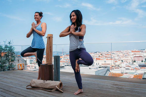 Christine Moghadam and Woman Practice on Cork Yoga Mat Outdoors in Portugal