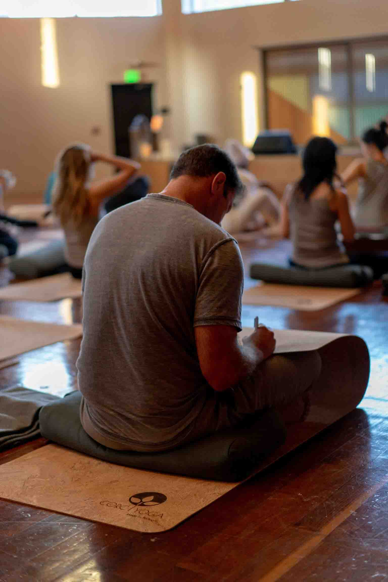 Man practicing yoga on cork yoga mat at Corc Yoga Wanderlust Event in Los Angeles