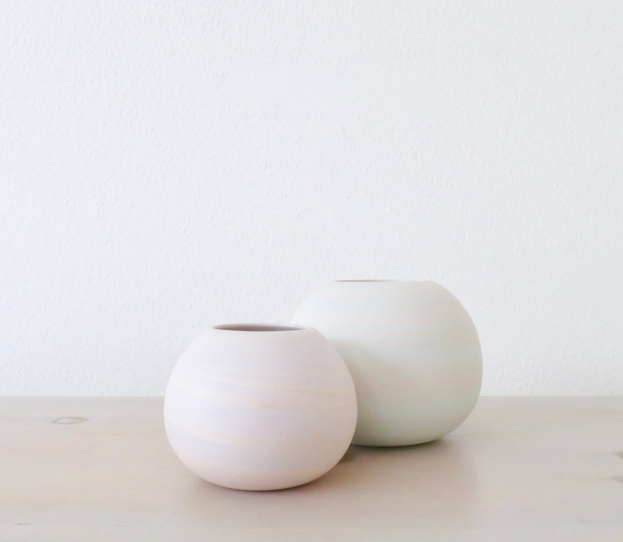PAIR OF MARBLE ORB VASES