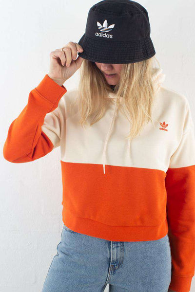Hoodie DU9945 I Creme og orange fra Adidas Originals