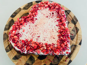 Giant heart valentines cake with freeze dried fruit decoration