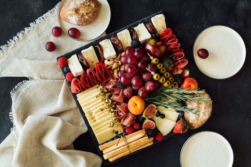 Stone tray with cheeses and cold meats