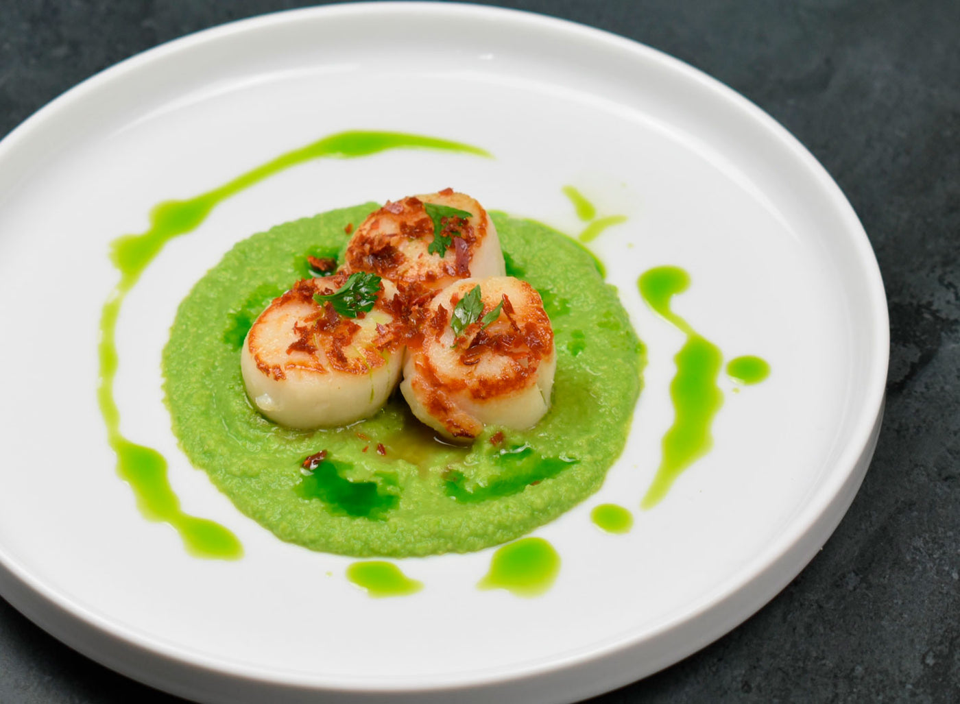 Parsley Herb Oil, Scallops, Pea Purée and Prosciutto