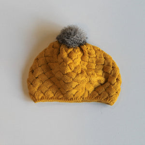 knitted pompom beret-style