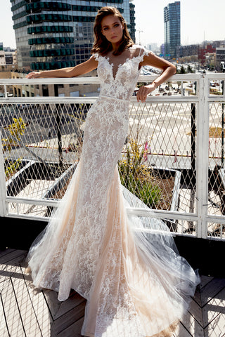 Limor Ben Yosef Jupiter Gown Multiple layers of white and silver sparkles for the perfect head turning look. Complete with a deep V cleavage embroidered with 3D laced flowers and manually embedded pearls.