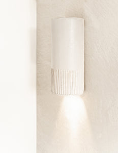 A stunning handmade ceramic wall light with textured lines. Made of flex ceramic. Handmade Australian lighting