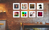 cool, eclectic, bohemian, pop art style gallery wall grid of 8 square 16x16 art prints with thin black picture frames set in a vintage industrial cafe with exposed brick walls and wooden tables.