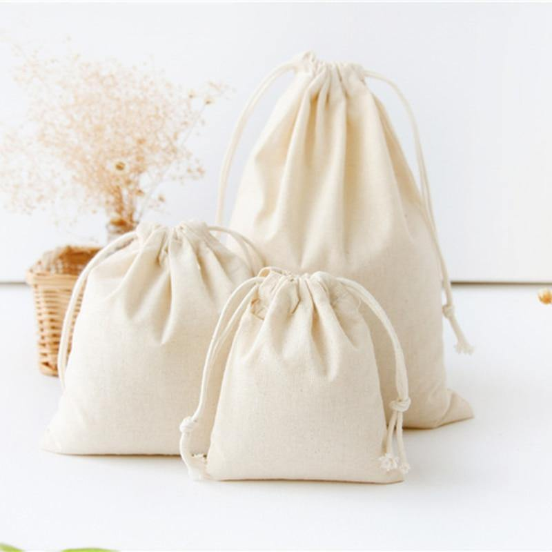 Natural Cotton Drawstring Storage Bags from Gallery Wallrus | Eclectic Wall Art & Decor with Worldwide Shipping