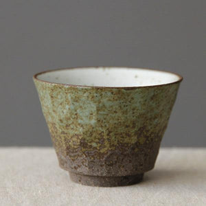 Green and Black Japanese Coarse Pottery Tea Cup from Gallery Wallrus | Eclectic Wall Art & Decor with Worldwide Shipping