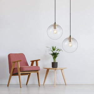 Minimalist Clear Round Pendant Lights from Gallery Wallrus | Eclectic Wall Art & Decor with Worldwide Shipping