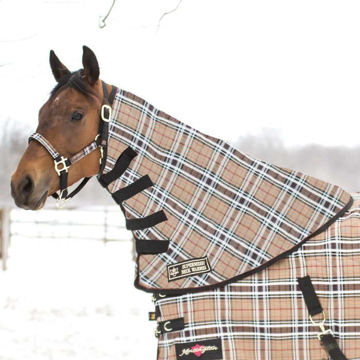 Horse in snow wearing tan, black, and white plaid neck warmer