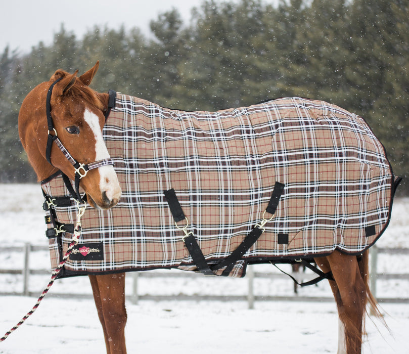 Kensington SuperMesh waterproof turnout winter blanket. Horse in snow. Brown, white and black plaid