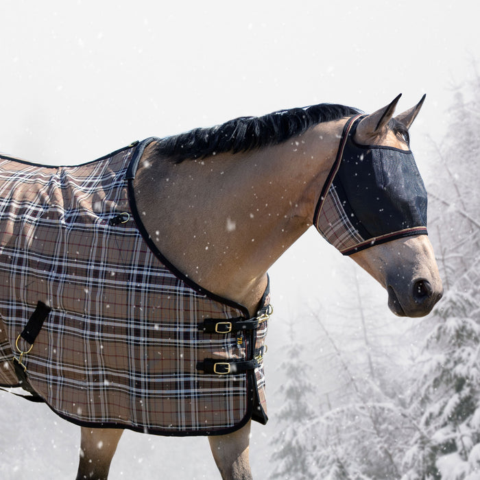 Kensington UViator Protective Fly Mask. 90% UV. Eye protection. Tan plaid with black. Horse in bright snow wearing matching winter blnaket