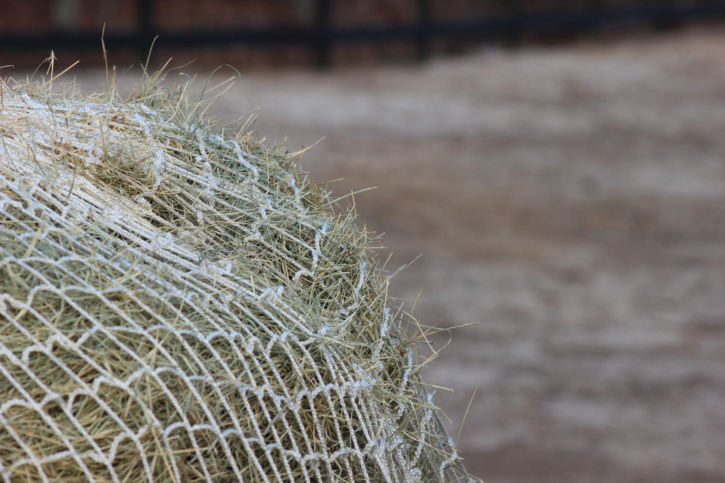 Freedom Feeder Round Bale Nets. Slow fed hay net